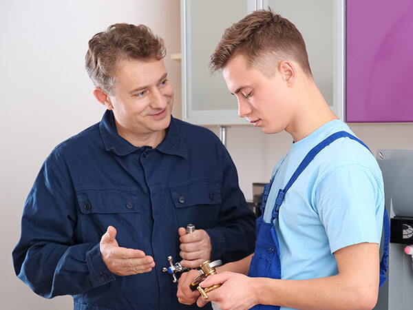 Young trainee recieving advice from experience worker